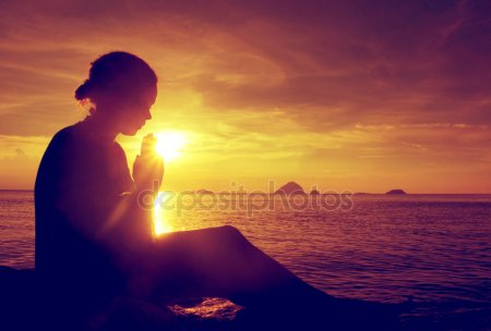 depositphotos_86266174-stock-photo-young-woman-praying-at-sunset